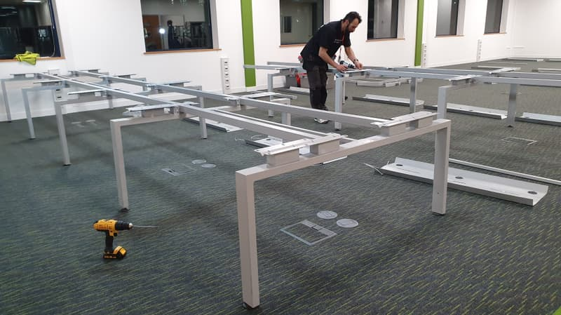installing banks of desks in new offices