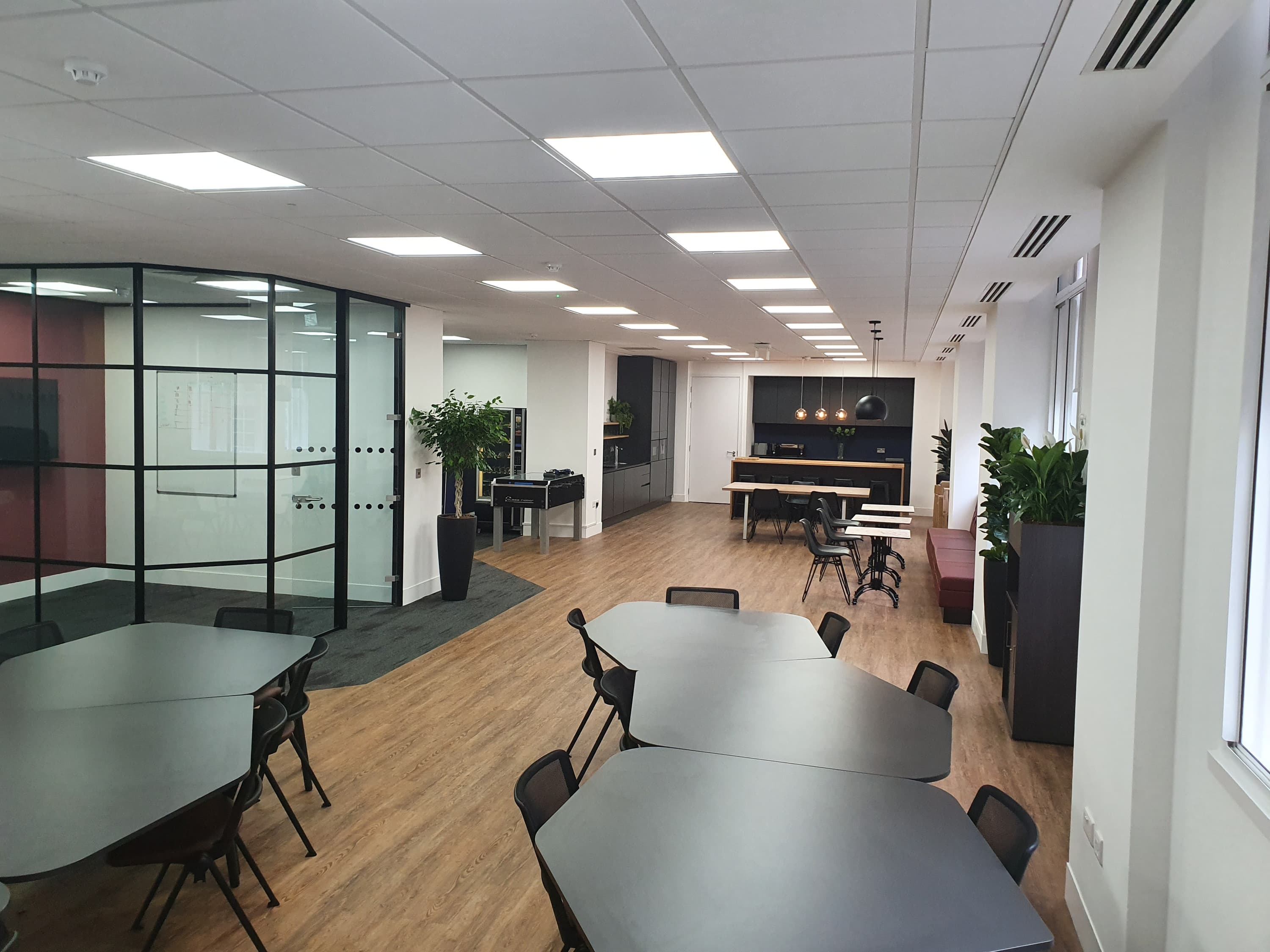 Large office breakout and refreshment area with crittal style partitions and