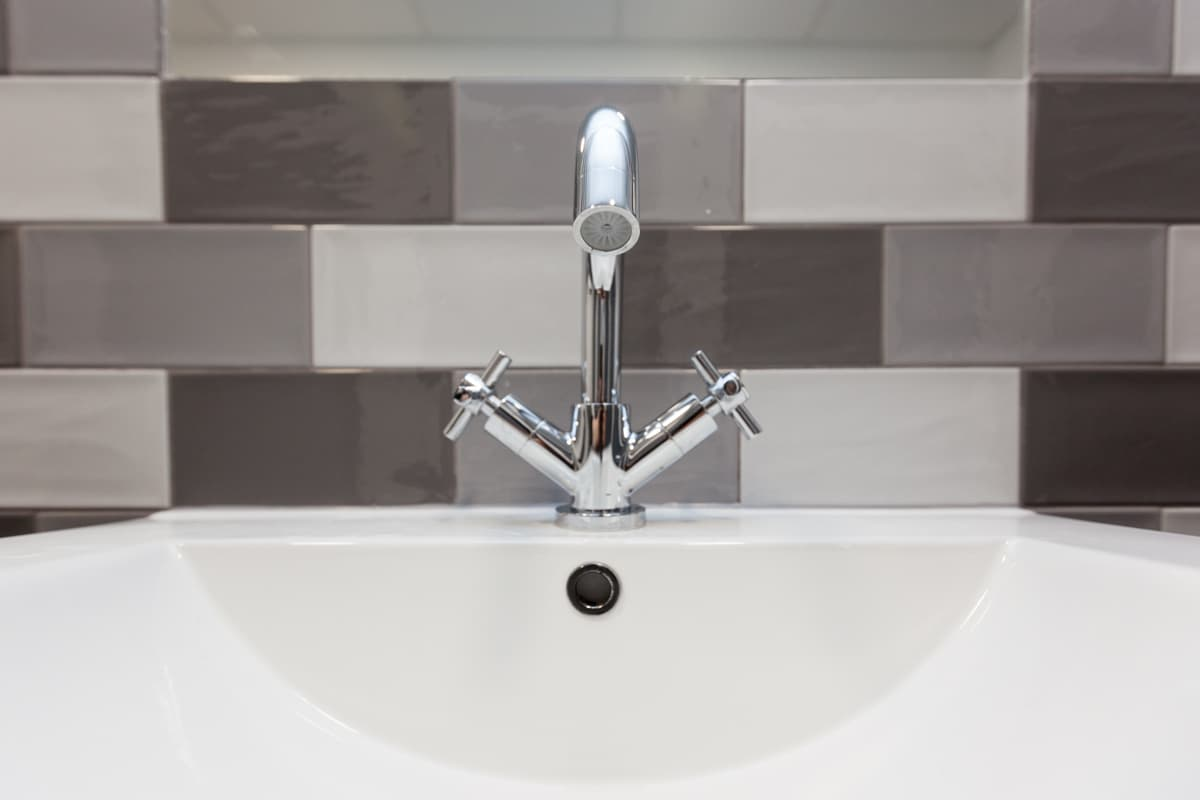 wash hand basin tap with geometric tiles