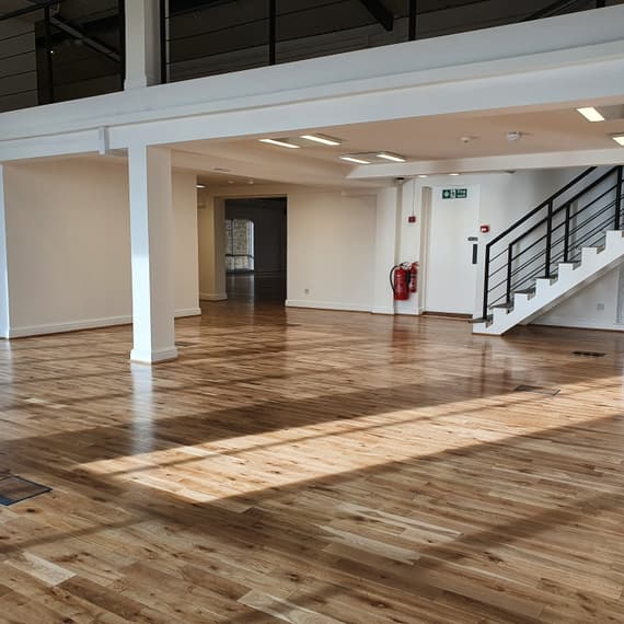 Totally clear empty office space with wood floor and mezzanine