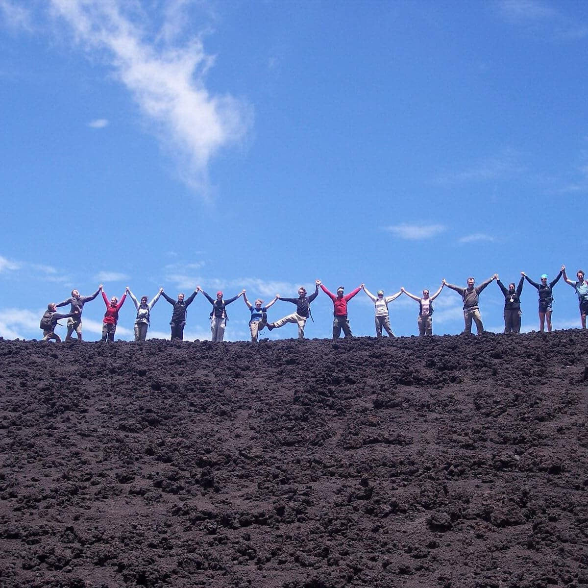 Pacaya Volcano Custom Tour Group Jumps for the camera